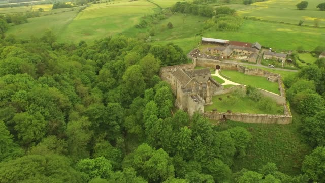 aydon castle aerial tracking left side - circa 14th century stock videos & royalty-free footage