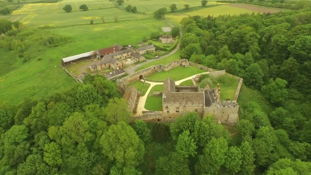 aydon castle aerial tracking shot rear - circa 14th century stock videos & royalty-free footage