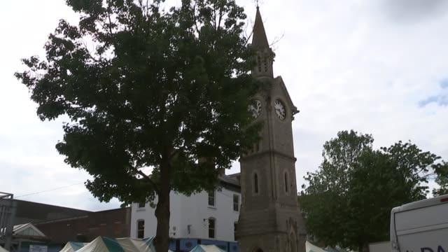 6 men jailed buckinghamshire aylesbury ext general views of aylesbury market square market stalls being erected / london david johnston interview... - taxi rank stock videos & royalty-free footage