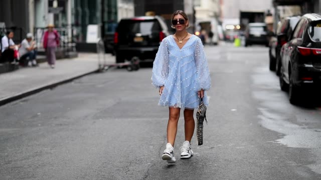 aylin koenig wearing blue dress ganni, sneaker louis vuitton, dior, sunglasses, bag, necklace is seen during new york fashion week spring/summer 2019... - trainer stock videos & royalty-free footage