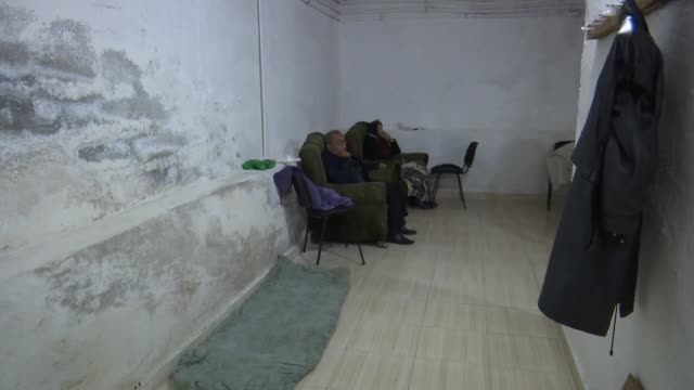 azerbaijani civilians have been living in shelters for ten days in the country's tartar city to protect themselves from armenia's violent attacks... - zahnbelag stock-videos und b-roll-filmmaterial