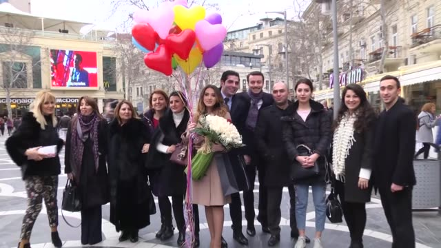 azerbaijani elsen memmedov proposes to his girlfriend naile kerimli after surprising her with a flash mob performance on valentine's day at fountains... - flash mob stock videos and b-roll footage