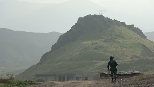 stockvideo's en b-roll-footage met azerbaijan's border guard patrol near the new khoda afarin dam also spelled as khodaafarin or hudafarin on the aras river straddling the... - benen gespreid