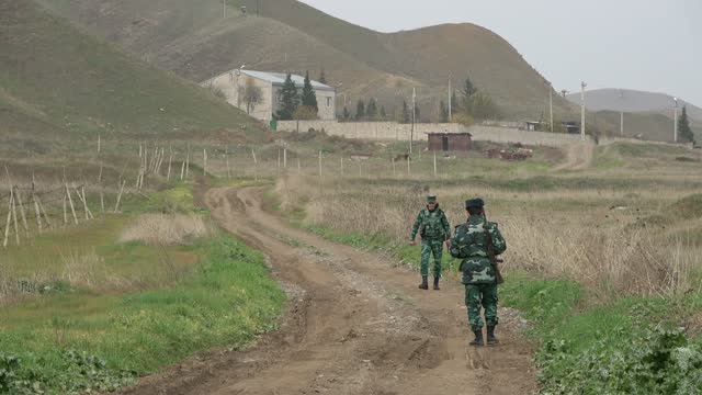 stockvideo's en b-roll-footage met azerbaijan's border guards patrol near the new khoda afarin dam also spelled as khodaafarin or hudafarin on the aras river straddling the... - benen gespreid