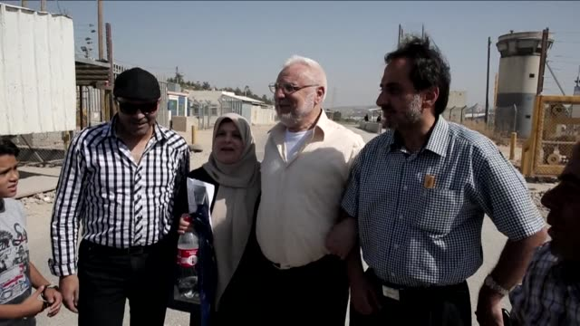 aziz dweik speaker of the palestinian legislative council was released from israeli prison outside the compound of the israeli ofer military prison... - compounding stock videos and b-roll footage