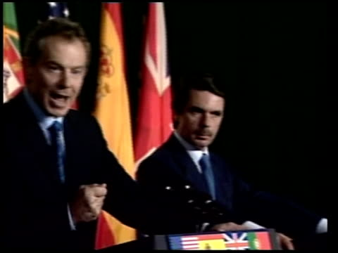 azores prime minister tony blair mp standing speaking at summit in azores pan bush watching - channel 4 news stock videos and b-roll footage