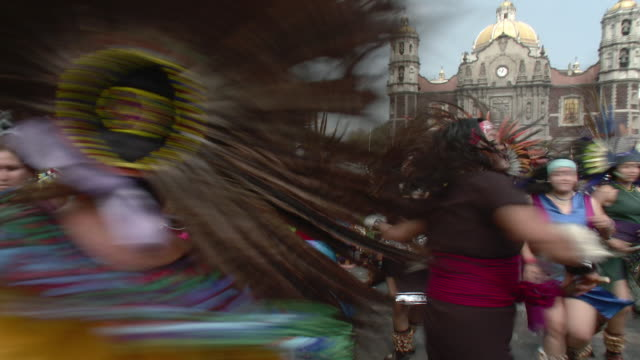 ms aztec dancers at basilica de guadalupe / mexico city, mexico - basilica stock videos and b-roll footage