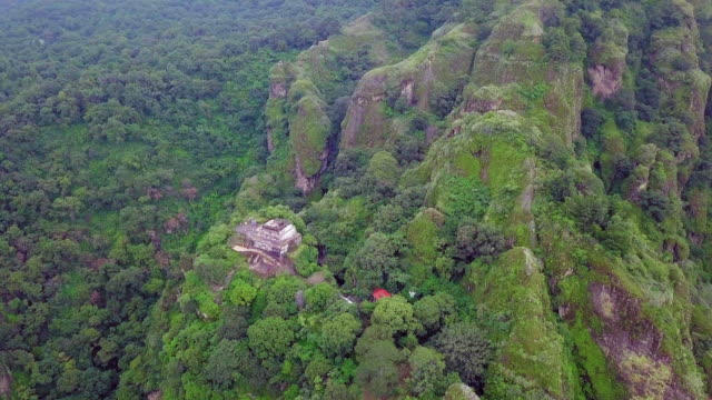 aztec pyramid over the tepozteco - aztec stock videos & royalty-free footage