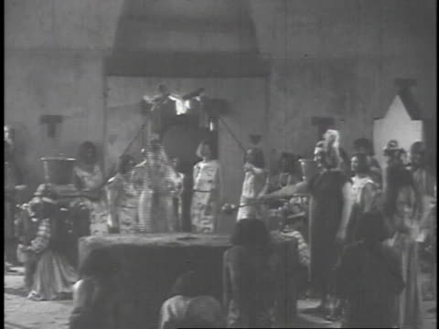 1923 reenactment aztec ritual involving a woman on an altar and fire in the background  - aztekisch stock-videos und b-roll-filmmaterial
