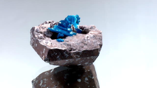 Azurite rotating on gray