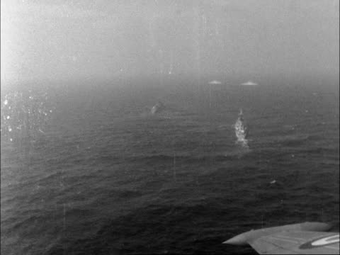b) air view ships air view as wreaths float air view four ships neg 16mm itn 20 secs 12.5 ft 31/5/66/dl north sea - anniversary stock videos & royalty-free footage