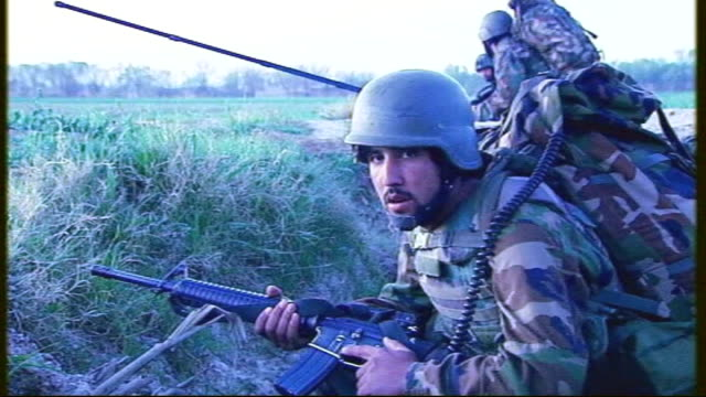 babaji british chinook helicopter drops afghan national army troops and british troops coldstream guards in field at dawn and flies off / coldstream... - night vision stock videos and b-roll footage