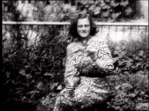 stockvideo's en b-roll-footage met babe didrikson in garden and with husband george zaharias babe didrikson in garden on july 01 1938 - 1938