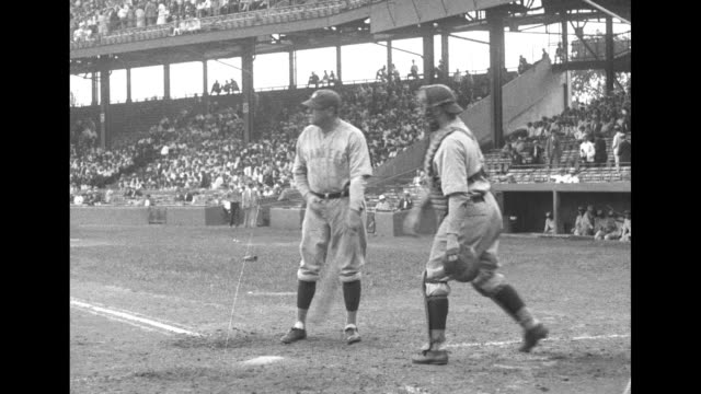 babe ruth and lou gehrig practice hitting at stadium with spectators in partly filled stands behind catcher throws balls offcamera / note exact year... - lou gehrig stock videos & royalty-free footage