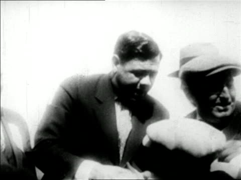 babe ruth being mobbed by fans as he shakes their hands / newsreel - one mid adult man only stock videos & royalty-free footage