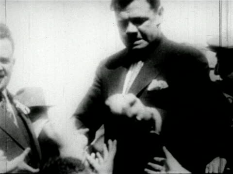 stockvideo's en b-roll-footage met babe ruth being mobbed by fans as he signs autographs / newsreel - 1927