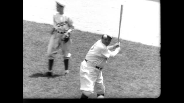 babe ruth in dressing room buttoning up dodgers uniform / babe hits balls before the crowd in dodgers stadium / new york yankees in the dugout... - anno 1938 video stock e b–roll
