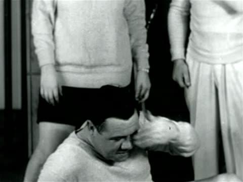 vídeos y material grabado en eventos de stock de babe ruth in sweatshirt on floor wiping sweat from brow / documentary - 1926