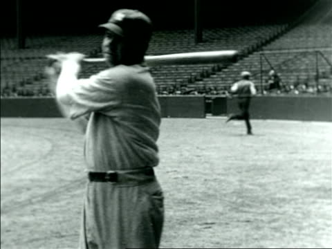stockvideo's en b-roll-footage met babe ruth in yankee uniform warming up with bat / documentary - 1921