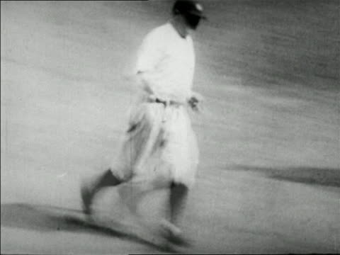 stockvideo's en b-roll-footage met babe ruth running bases in game sliding into home plate / news - 1927