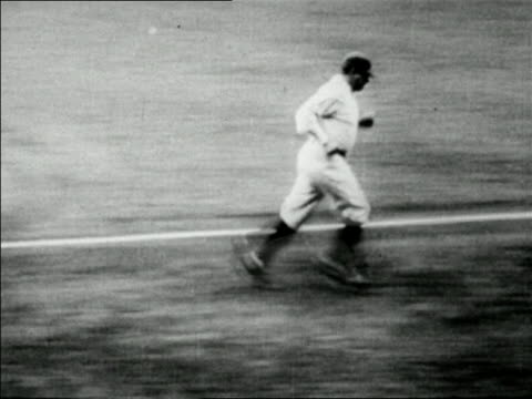 Babe Ruth saluting running to home plate after hitting home run / newsreel