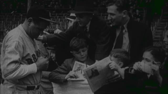 vídeos y material grabado en eventos de stock de babe ruth signs ball for some young fans / united states - 1933