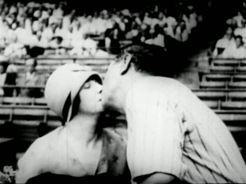 Babe Ruth sister Mamie kissing each other in ballpark / newsreel