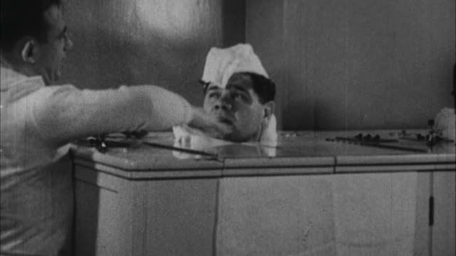 babe ruth sits in steam bath and is made fun of by trainer / united states / audio - spa treatment stock videos & royalty-free footage