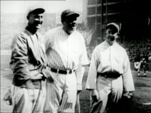 babe ruth standing between ty cobb and eddie collins in stadium / newsreel - ty cobb baseball player stock videos and b-roll footage