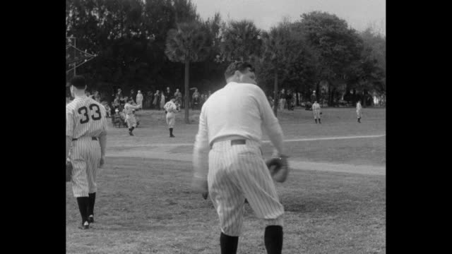 Babe Ruth talks with manager Joe McCarthy throws ball / Vernon 'Lefty' Gomez catches throws ball Lefty Gomez / Benny Chapman bats / Benny Chapman...