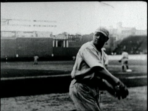 Babe Ruth warming up with the Red Sox throwing baseball / baseball game / Babe Ruth hitting ball crowds cheering him on Babe Ruth breaks all home run...