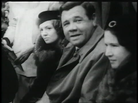 stockvideo's en b-roll-footage met babe ruth waves from stands / polo grounds new york city new york united states - 1936