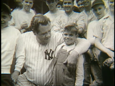 B/W Babe Ruth with arms around 2 young boys
