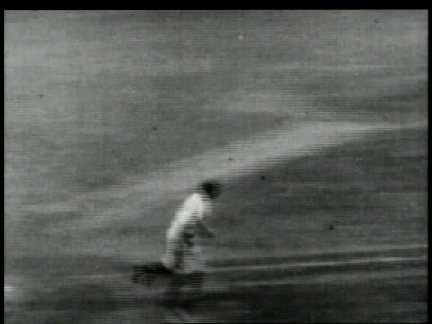 stockvideo's en b-roll-footage met babe smiling at crowd / hitting a home run and running the bases / crowd cheering - 1949