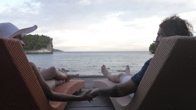 babe, this trip is just what we needed - outdoor chair stock videos & royalty-free footage