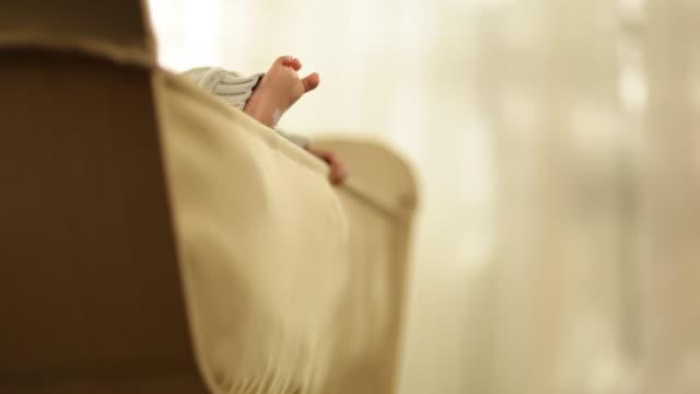 vídeos y material grabado en eventos de stock de babies activity in baby crib - sólo niños bebés
