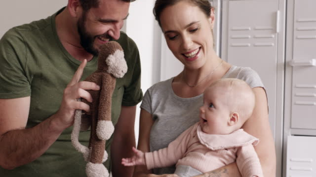 babies fill a home with happiness - weekend activities stock videos & royalty-free footage