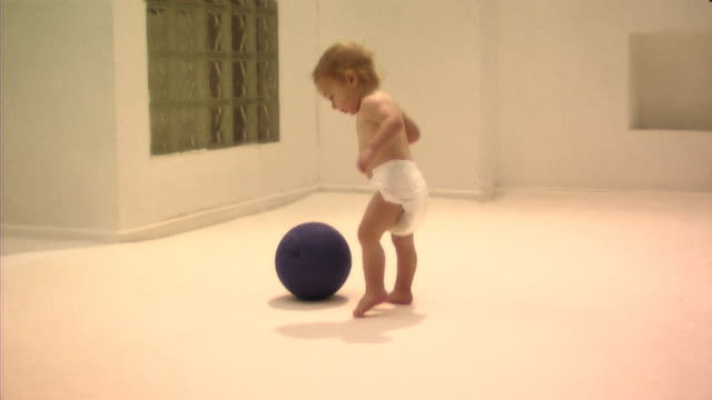 Babies playing with ball