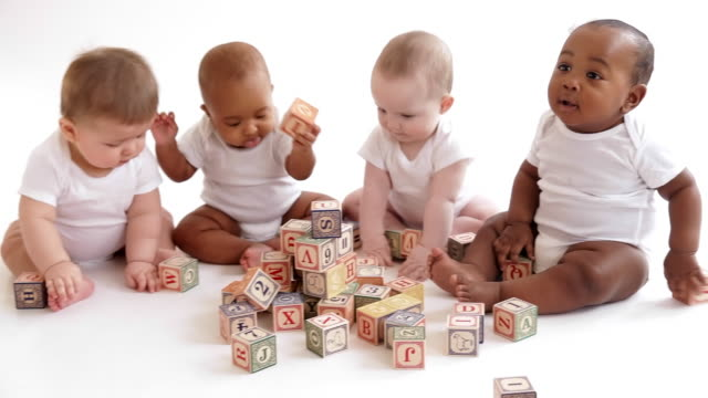 Babies playing with wooden blocks