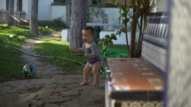 stockvideo's en b-roll-footage met babies ruining smartphones - one baby boy only