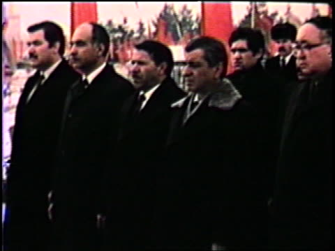 babrak karmal and group of party functionaries attending soviet styled march honoring those killed while fighting rebels / honorary wreaths are laid... - rebellion stock videos & royalty-free footage