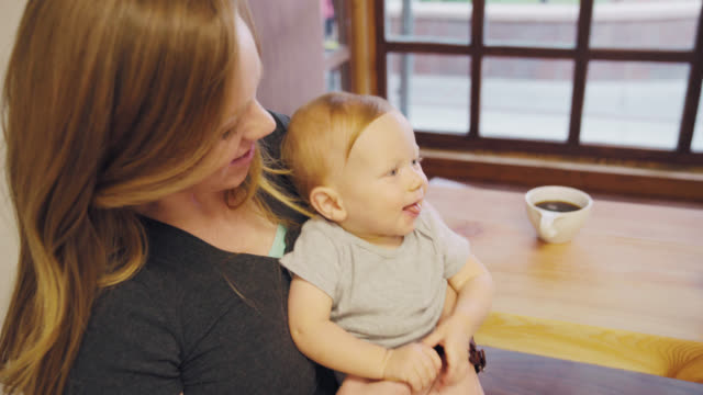 baby and mom at a cafe - seattle coffee stock videos and b-roll footage