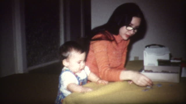 baby and puzzle 1960's - moving image stock videos & royalty-free footage