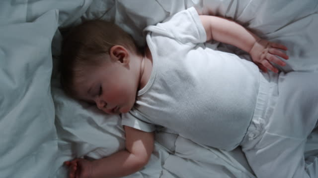 baby asleep on a bed - physical activity stock videos & royalty-free footage