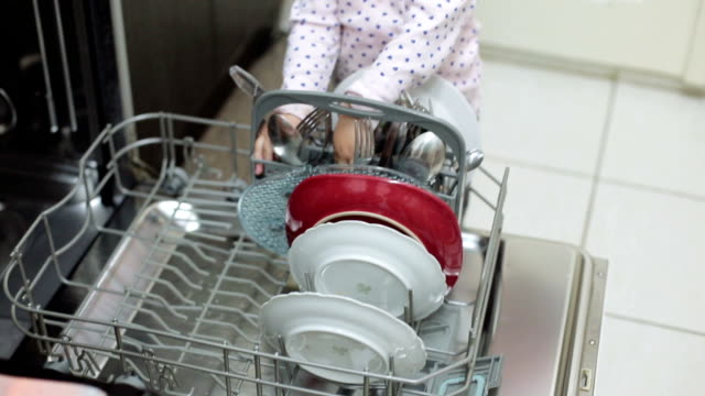 baby assisting her mother with dishes and mother is baking pizza in owen - dishwasher stock videos & royalty-free footage