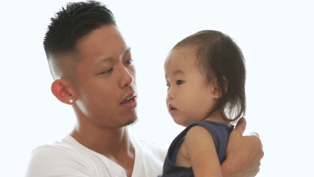 baby being hugged by his father. - role reversal stock videos & royalty-free footage