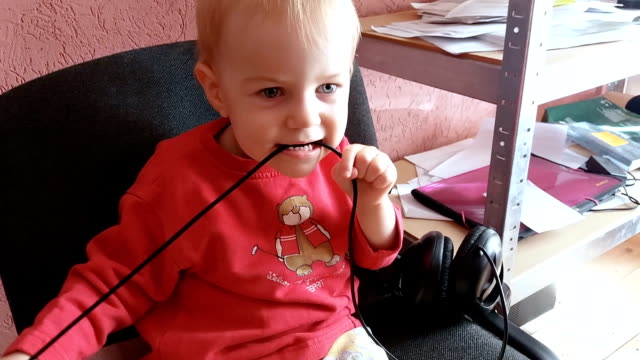 baby biting the wire caution danger consept - chewing stock videos & royalty-free footage
