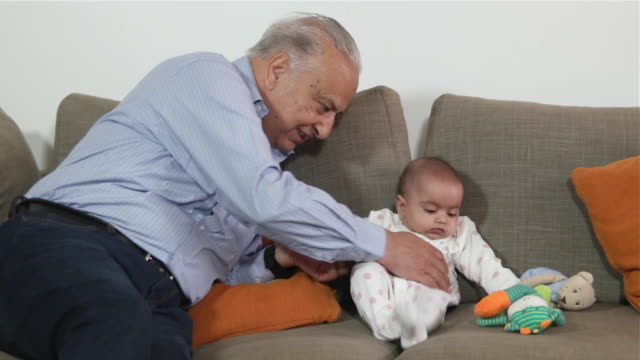 A baby bonds with her grandfather