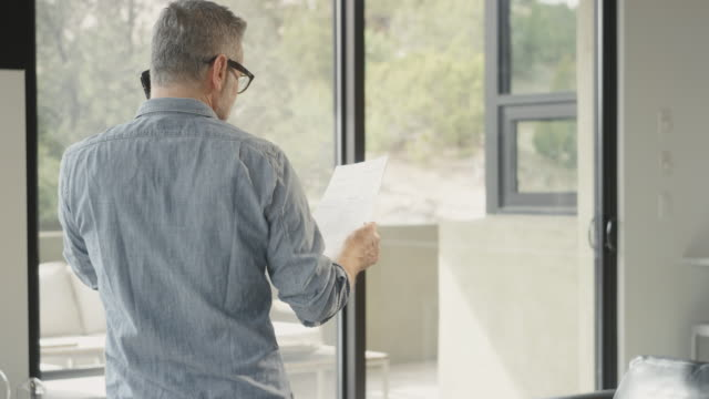 baby boomer man working in home office