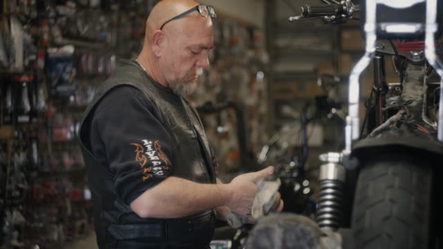 baby boomer man working on motorcycle
